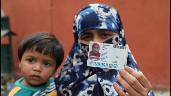 A Rohingya woman shows her UN-issued refugee card in Jammu on Saturday. (HT PHOTO)