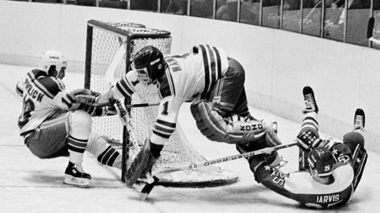 FILE - In this Dec. 7, 1983, file photo, Washington Capitals' Doug Jarvis (25), right, scores a goal against New York Rangers goalie Glen Hanlon during the first period of an NHL hockey game at Madison Square Garden in New York. The puck slides into the goal off the skates of Rangers' Mark Pavelich, left. Pavelich has died at a treatment center for mental illness. Officials in Anoka County, Minnesota, (AP)