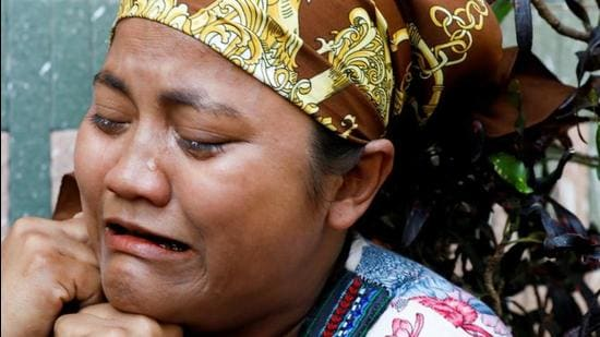 A relative of U Khin Maung Latt, 58, a National League for Democracy (NLD)'s ward chairman, cries as she receives his body from a hospital in Yangon, Myanmar on March 7, 2021. (REUTERS)