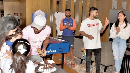 Virat Kohli and Anushka Sharma at a birthday party.