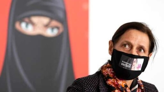 Monika Ruegsegger-Hurschler, National Councillor SVP, gives an interview at the meeting place of the supporters of the initiative to ban face coverings.(AP)