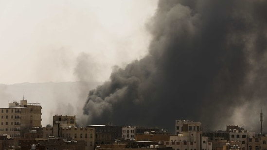 Smoke and dust rise near buildings from what a Reuters witness and residents said was air strikes launched by Saudi-led coalition on Sanaa,.(REUTERS)