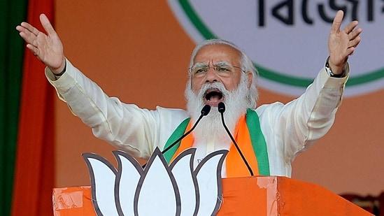 Prime Minister Narendra Modi addressing during a public rally at Brigade Parade Ground in Kolkata on Sunday. (ANI Photo )