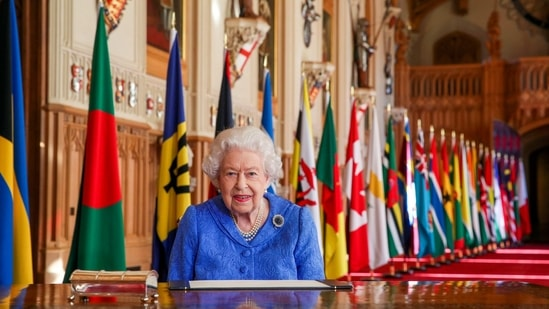 In this photo made available Sunday March 7, 2021, Britain's Queen Elizabeth II poses for a photo while signing her annual Commonwealth Day Message inside St George's Hall at Windsor Castle, England, Friday March 5, 2021. (Steve Parsons/Pool via AP)(AP)