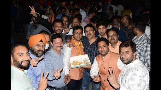 Nitin Mahajan group celebrating their win outside Lodhi Club in Ludhiana on Sunday. (Harsimar Pal Singh/HT)