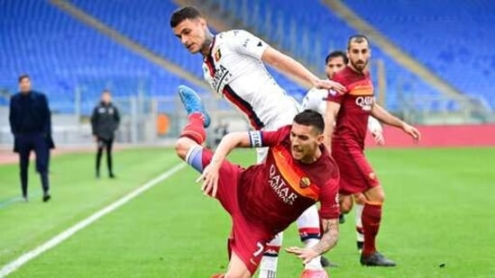 Roma's Lorenzo Pellegrini, foreground is challenged by Genoa's Gianluca Scamacca during the Serie A soccer match between Roma and Genoa at the Rome Olympic Stadium Sunday, March 7, 2021. (AP)