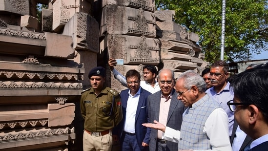 In this file, Nripendra Mishra, the chairman of the Ram Temple Construction Committee along with Senior VHP leader Champat Rai during their inspection at Ramjanmabhoomi Nyas kaaryashala, in Ayodhya. (PTI Photo)