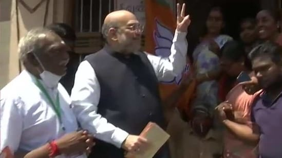 Home minister Amit Shah during his door-to-door campaign in Kanyakumari on Sunday.(ANI Photo)