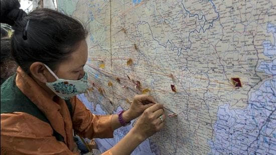 A file photo showing a Tibetan in-exile pinning a small flag on a map of Tibet to commemorate the 108th anniversary of the declaration of Tibetan Independence Day, at Mcleodganj in Dharamshala, India on February 13, 2021. (PTI)