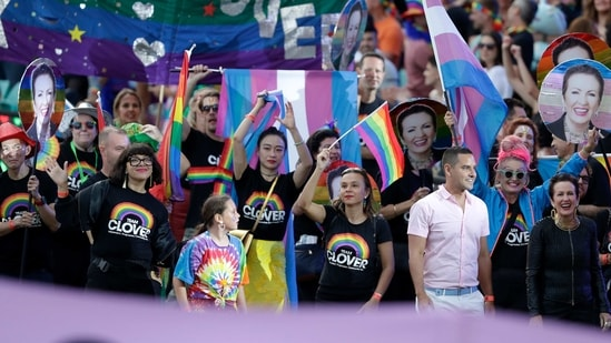Sydney's Mayor Clover Moore, bottom right, marches in the Gay and Lesbian Mardi Gras parade at the Sydney Cricket Ground in Sydney, Saturday, March 6, 2021. The annual event has been forced into a sport stadium due to Covid-19 restrictions.(AP)