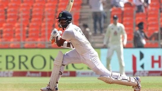 Washington Sundar drives en route to his highest Test score. (BCCI)