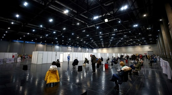 General view of vaccine recipients waiting at Messe Wien Congress Center, which has been set up as a coronavirus disease (COVID-19) vaccination centre, in Vienna, Austria(AFP)