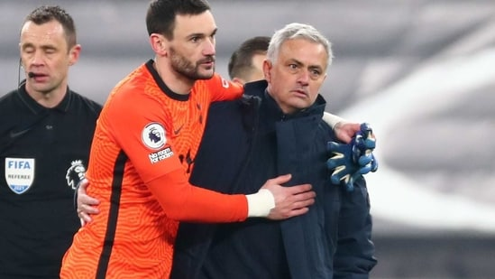 Tottenham Hotspur's Hugo Lloris celebrates with manager Jose Mourinho after the match (REUTERS)