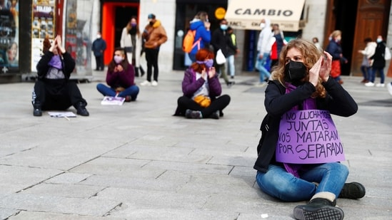 """People gather in a demonstration to mark International Women's Day, despite of being banned by local authorities due to COVID-19 restrictions, at Puerta del Sol square in Madrid, Spain, March 8, 2021. The sign reads: """"We do not fight together, they will kill us separately"""". REUTERS/Sergio Perez(REUTERS)"""