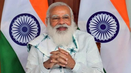 Prime Minister Narendra Modi addresses through video conference, in New Delhi on Sunday. (ANI Photo)