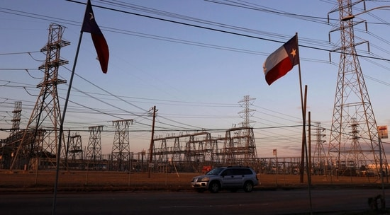 Texas flags fly near an electrical substation on February 21, 2021 in Houston, Texas.(AFP)