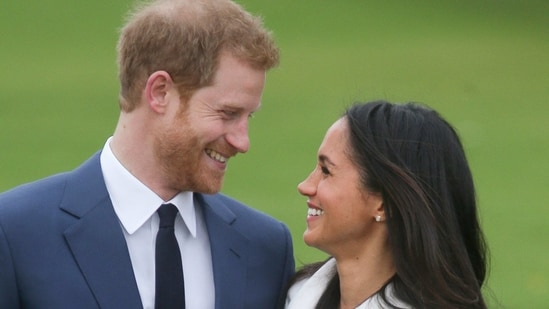 (FILES) In this file photo taken on November 27, 2017 Britain's Prince Harry and his fianc�e US actress Meghan Markle pose for a photograph in the Sunken Garden at Kensington Palace in west London, following the announcement of their engagement. - Meghan Markle has experienced remarkable highs and lows during a tumultuous period in which she married into royalty and became a mother before souring on life in Britain and returning to the United States. The 39-year-old American former television actress shot to global stardom with her engagement to Prince Harry in 2017 and their fairytale wedding six months later. She gave birth to their son, Archie, in 2019. (Photo by Daniel LEAL-OLIVAS / AFP)(AFP)