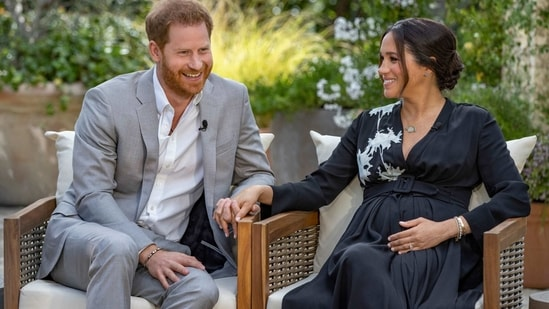 Undated: This image provided by Harpo Productions shows Prince Harry, left, and Meghan, Duchess of Sussex, during an interview with Oprah Winfrey. (AP)