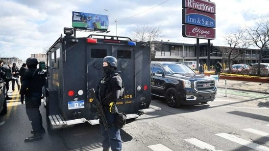 Detroit police monitor the scene of a shooting at the Rivertown Inn and Suites on East Jefferson Avenue in Detroit.(AP)