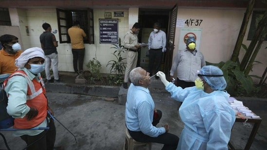 """In the report, the deputy chief minister was quoted as saying that the government believed that the """"only way to stop the spread of this virus is to test aggressively.""""(AP)"""