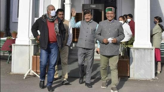 Congress legislator's along with CPI(M) MLA Rakesh Singha staging a walkout from the assembly during the budget session in Shimla on Monday. (HT Photo)