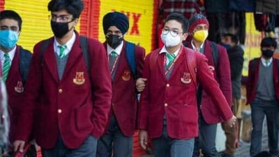 Students wearing masks arrive to attend a school in Srinagar, Indian controlled Kashmir, Monday, March.1, 2021. Schools reopened Monday for classes 8 to 12 in Indian-controlled Kashmir, eleven months after being closed due to the coronavirus pandemic. (AP Photo/Mukhtar Khan)(AP)