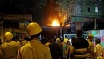 Firefighters and locals stand and watching fire after it broke out on the 13th floor of a multi-storeyed building and housing offices of the Railways, on Strand Road in Kolkata on Monday. (ANI Photo)