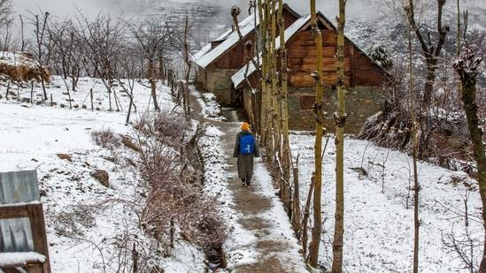 A Kashmiri boy walks homeward after attending private classes, after a brief spell of fresh snowfall in the outskirts of Srinagar Indian controlled Kashmir, Saturday, Feb. 27, 2021. (AP Photo/ Dar Yasin)(AP)