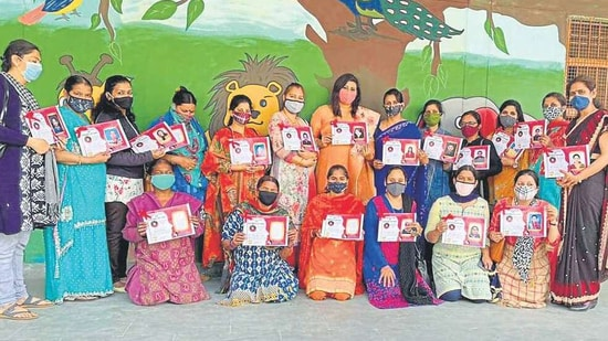 Teachers and midday meal cooks being honoured during a function on Women's Day at Government Primary School, Haibowal, on Monday. HT PHOTO