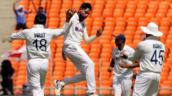 India's Mohammad Siraj celebrates a dismissal with teammates during the 4th Test Match between India and England at Narendra Modi Stadium in Ahmedabad on Thursday. (BCCI/ANI Photo)