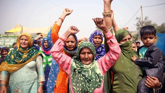 Women farmer's shout slogans on the occasion of International Women Day during a protest against the new farm laws at Singhu Border, in New Delhi on Monday. (ANI Photo)