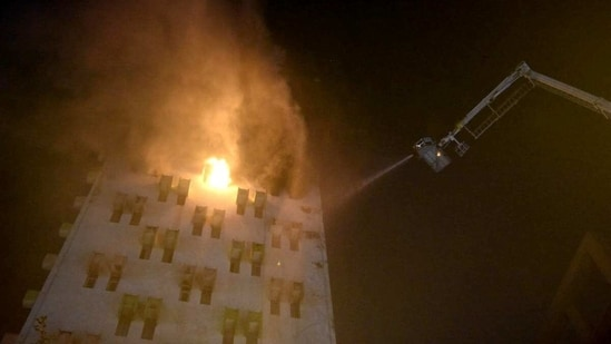 Firefighters try to put out a fire that broke out in a multistory building in Kolkata on Monday. (ANI Photo)
