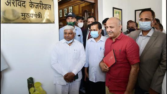 Delhi chief minister Arvind Kejriwal and deputy chief minister Manish Sisodia arrive at Vidhan Sabha to attend the Budget session, in New Delhi, Tuesday. (PTI)