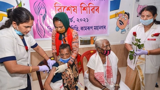 Elderly citizens receive Covid vaccine shots in Guwahati on Monday.(PTI Photo)