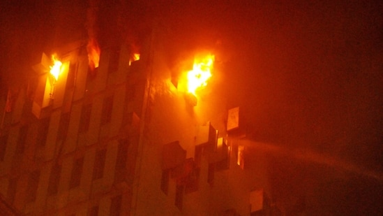 The fire broke out at the 13th floor of a multi-storeyed building in Kolkata, on Monday evening.(PTI Photo)