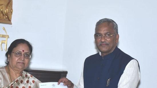 Trivendra Singh Rawat (right) on Tuesday submitted his resignation to Governor Baby Rani Maurya. (HT Photo)