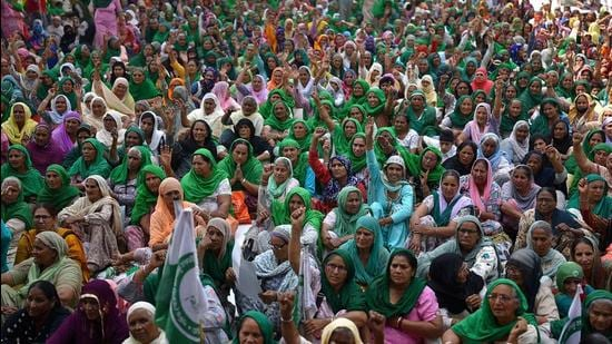 Women join the protesting farmers at Tikri border in New Delhi on March 8. (AFP)