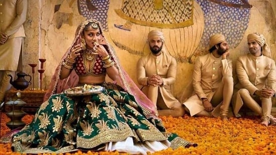 In one shot Masaba Gupta can be seen dolled up as a Sabyasachi bride as she enjoys a quick bite.(Instagram)