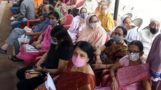 People wait for their turn to receive the dose of Covid-19 vaccine, in Patna on Tuesday.(ANI Photo)