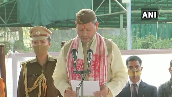 Tirath Singh Rawat taking oath as Uttarakhand CM.(ANI)