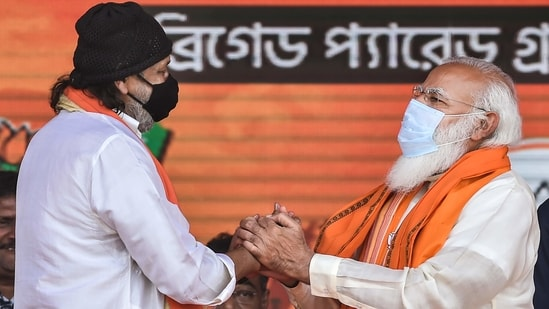 Prime Minister Narendra Modi with Bollywood actor Mithun Chakraborty after he joined BJP during a public meeting ahead of West Bengal Assembly Polls. (PTI Photo)