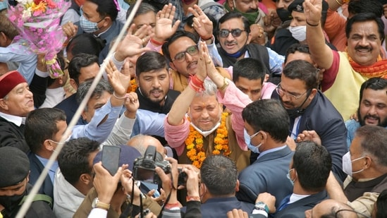 BJP leader Tirath Singh Rawat greets his supporters after he was elected as new Chief Minister of Uttarakhand, in Dehradun, Wednesday, March 10, 2021. (PTI Photo)