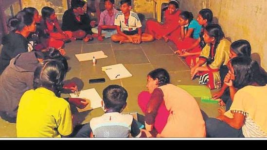 The students gather at a study circle at the Sanjay Nagar slums. HT PHOTO
