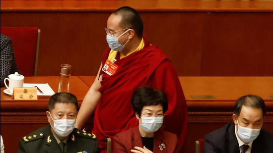 Gyaltsen Norbu, the Chinese-appointed 11th Panchen Lama, arrives for the opening session of the Chinese People's Political Consultative Conference (CPPCC) at the Great Hall of the People in Beijing on March 4, 2021. (REUTERS)