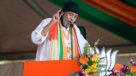 Bollywood actor Mithun Chakrabarty gestures as he delivers his speech after joining the BJP ahead of West Bengal elections in Kolkata, on Sunday.(AP Photo)