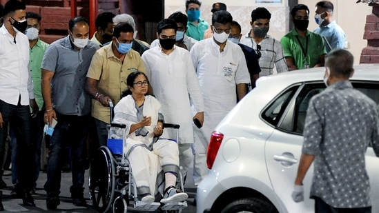 West Bengal chief minister Mamata Banerjee is wheeled out after being discharged from the SSKM Hospital in Kolkata on Friday. (ANI PHOTO).