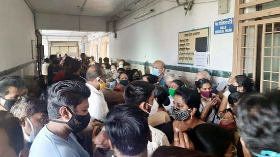 People flouting social distancing norms as they stand in a queue to get dose of Covid-19 vaccine, at a Kamla Nehru Hospital vaccination center in Pune on Monday. (ANI)(HT_PRINT)