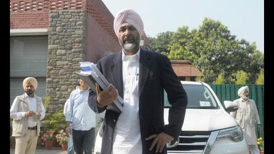 Punjab finance minister Manpreet Singh Badal leaving for the assembly to present the budget for 2021-22 in Chandigarh on March 8. (Ravi Kumar/HT)