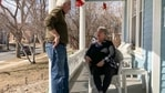 In this March 8, 2021, photo, Jaci Jageson talks with her husband Larry Lageson on the porch of their home in Mankato, Minn. The retired couple's precinct is one of several in the small, Midwestern city where heavy support for Joe Biden last year helped the Democrat carry Blue Earth County, where Republican Donald Trump won in 2016. (AP Photo/Tom Beaumont)