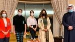 Founder of Lan Asket campaign, from left, Lina al-Qaddoumi, Najeeba Hayat, Shayma Shamo and Ascia al-Faraj, stand beside Abdulaziz al-Saqabi, one of the Kuwaiti politicians who has proposed an amendment to the penal code to define and punish sexual harassment in Kuwait City, Kuwait.(AP)